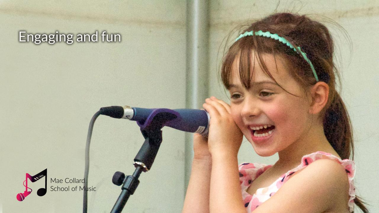 Girl singing into microphone with big smile - Engaging and fun